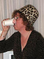 Her Serene Tackiness, Julie Mangin, demonstrates the Pick Your Nose party cups